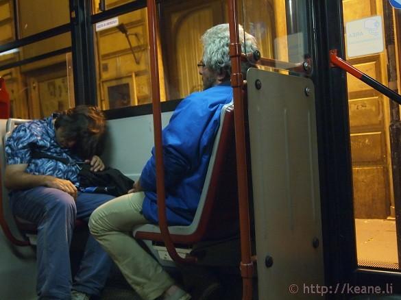 Sleeping passengers on night bus to Roma Termini