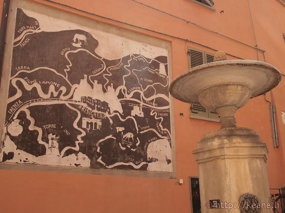 Brisighella town center fountain map plaque