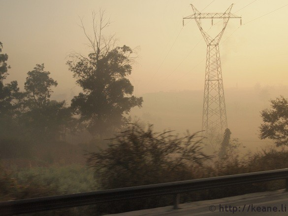 Power lines in haze along the freeway from Kunming to Dali