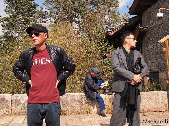 Three guys dressed three different ways on Qinglong Bridge in Shu He