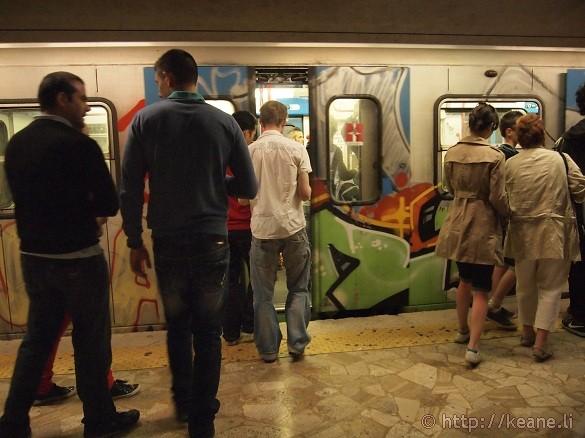 Graffiti-covered train at Stazione Termini