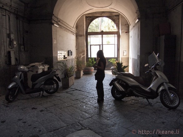 Woman in building courtyard in Naples