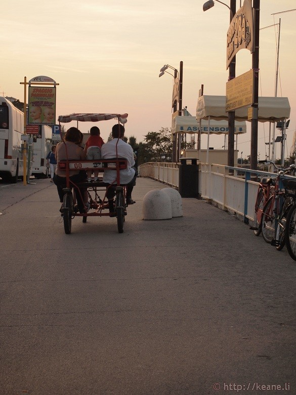Family biking along the Rimini beachfront