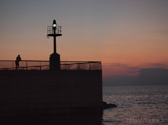Rimini at Night - Man on Pier