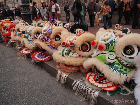 Chinese lion heads along Market Street before the Chinese New Year parade