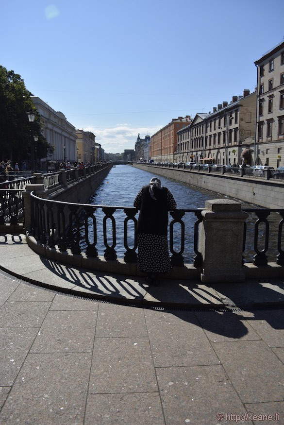 Woman Stands by St. Petersburg Canal
