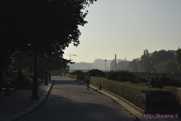 Notre Dame Cathedral - Woman Walking in the Early Morning