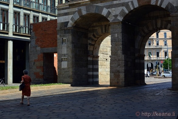 Woman Walking by Ancient Arches in Milan