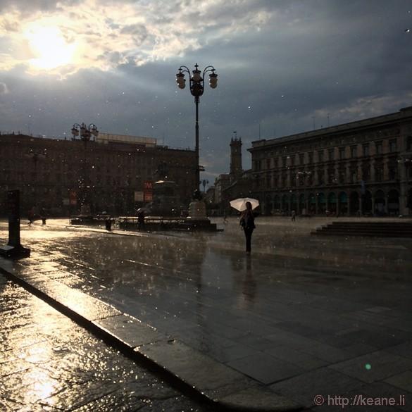 Girl with Umbrella in the Rain in Milan's Piazza del Duomo