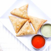 Crispy Samosas - Vegetarian at AED 10, Chicken & Mutton options at AED 12