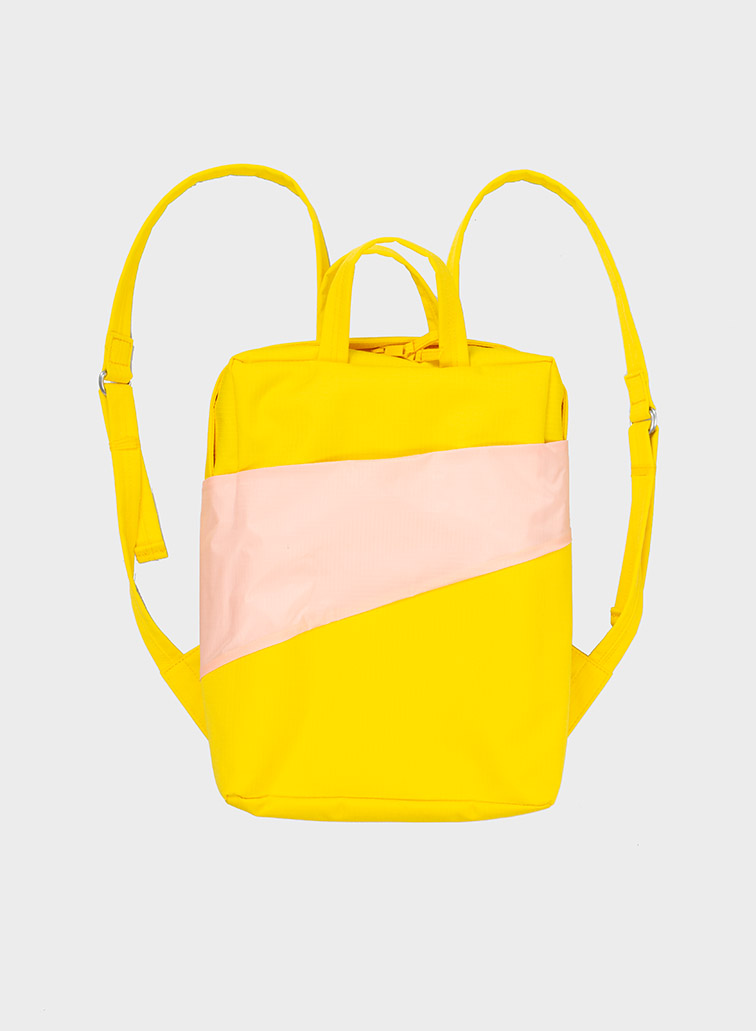 The new Backpack tv yellow & powder