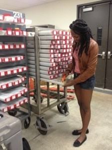 Figure 2. Nishaila Porter selecting cores at IODP.