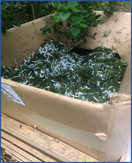 Recycling KEE Shredded paper and mixing it with grass cuttings
