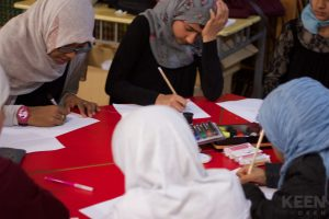 drawing their design on paper