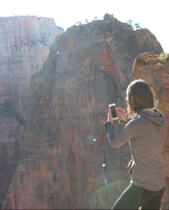 person taking picture of mountains