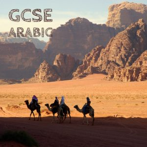people riding camels in a desert
