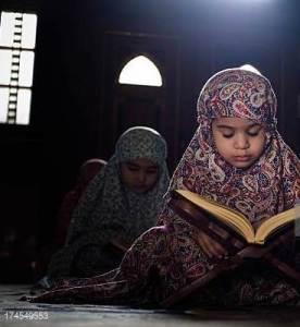 muslim girl learning Qur'an