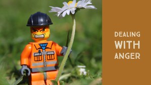 angry lego man holding flower