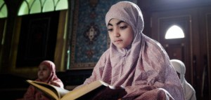 muslim girl learning Qur'an