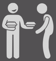 person giving food to another person