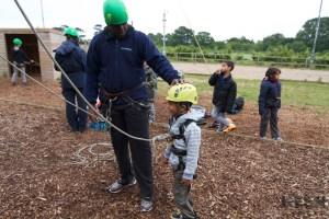 boy preparing to climb tower