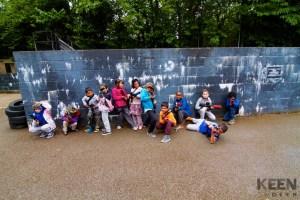 group of kids holding laser tag gun posing
