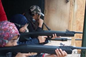 girl aiming rifle gun