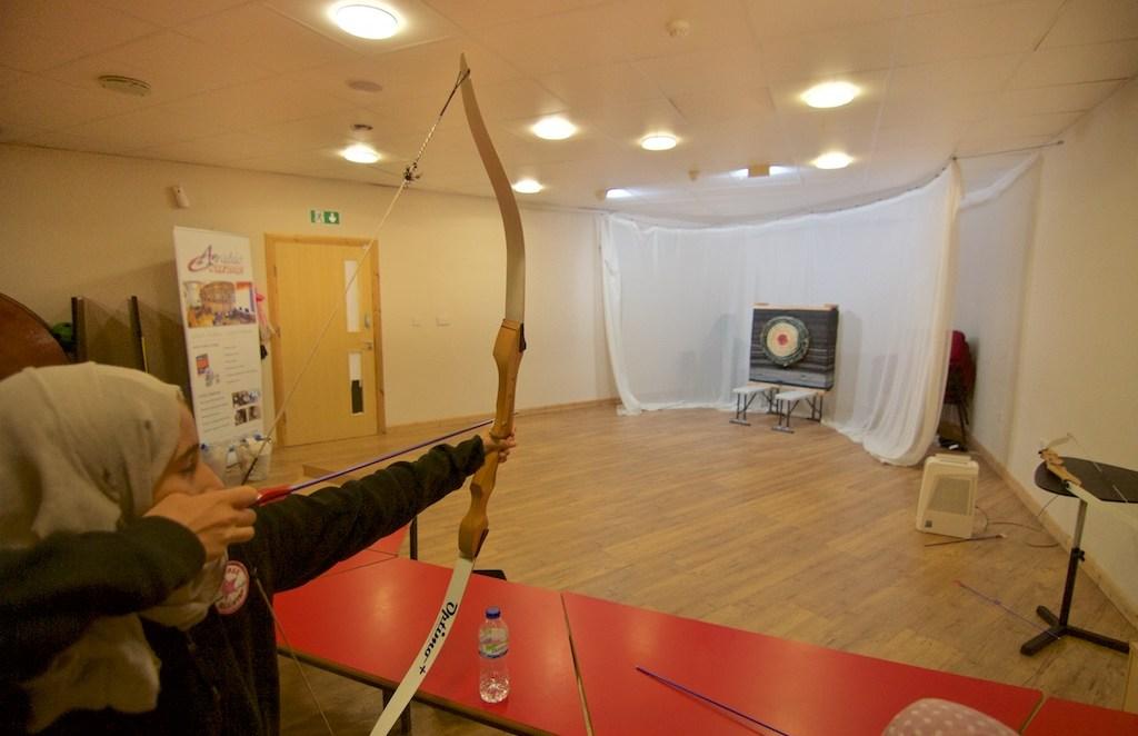 girl aiming the arrow