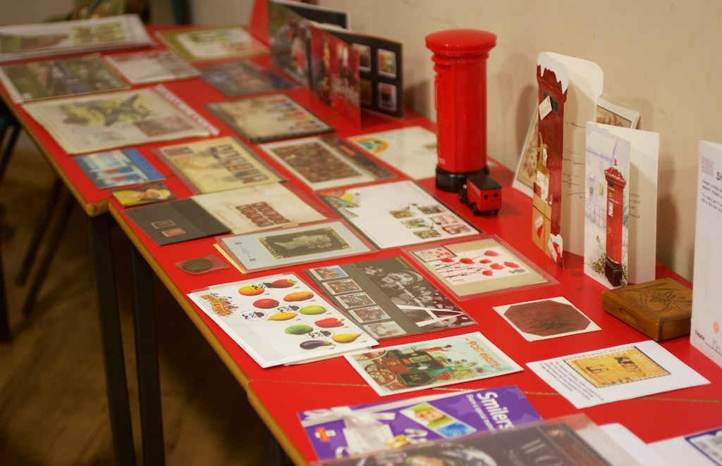 Stamp collections and books on the table