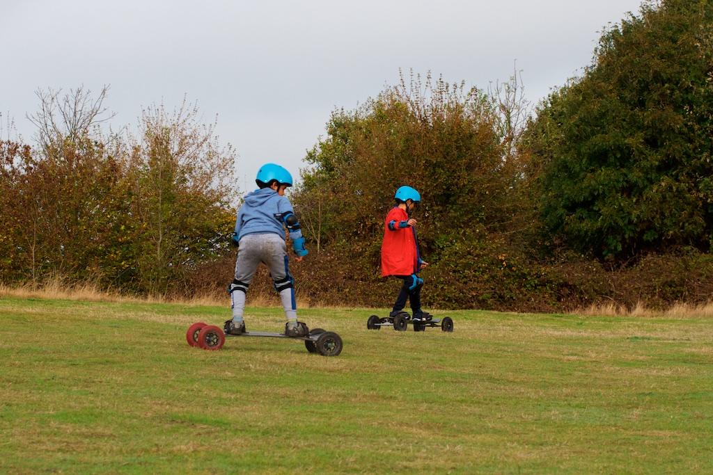 Boys skateboarding on a hill