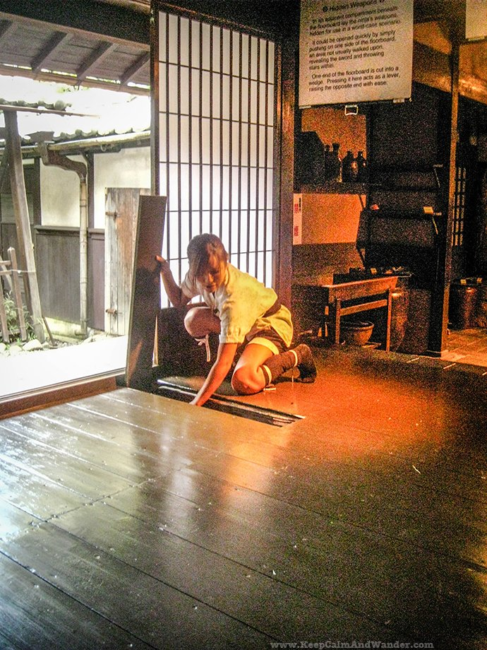 The girl demonstrates how ninjas move quickly from one place to another at Iga Ninja Museum Ueno.