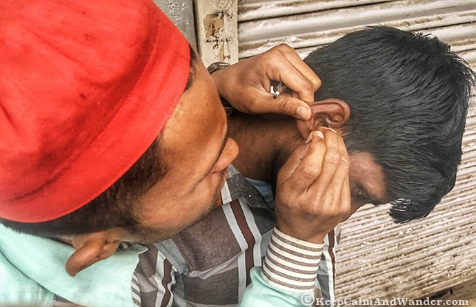 Street ear cleaning is a thing in India.