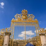 The Golden Gate of the Palace of Versailles Displays Excess Opulence of French Royalty