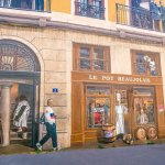 This Building is Coated with Mural Paintings of Famous People From Lyon
