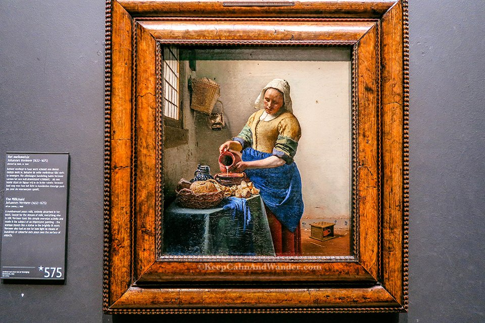 The Milkmaid by Johannes Vermeer inside Rijksmuseum in Amsterdam (Netherlands).
