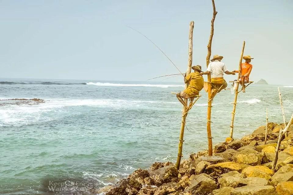 These Fishermen on Stilts in Sri Lanka are Fishing for Money (Galle, Sri Lanka).