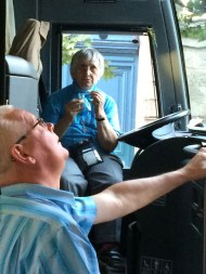 The coach driver with our other 'driver', Sr Lorenza in the driver's seat. Image courtesy: I. Demase, 2014.