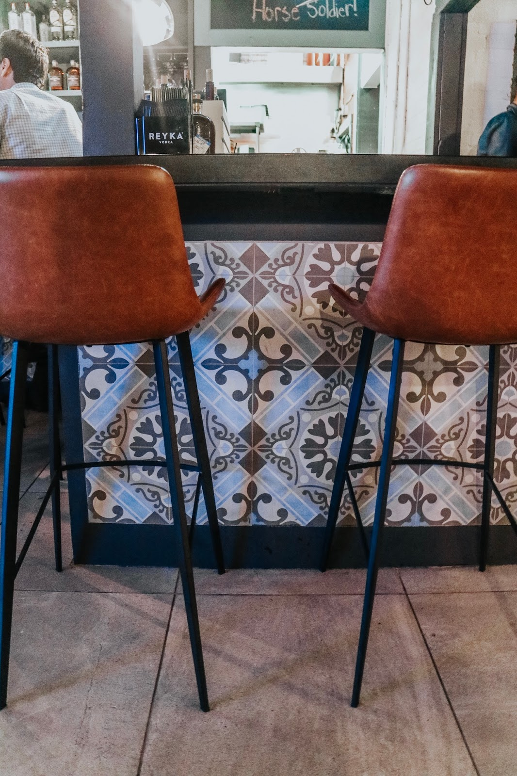 Bar stools and tiled bar decor at boca in Tampa Florida