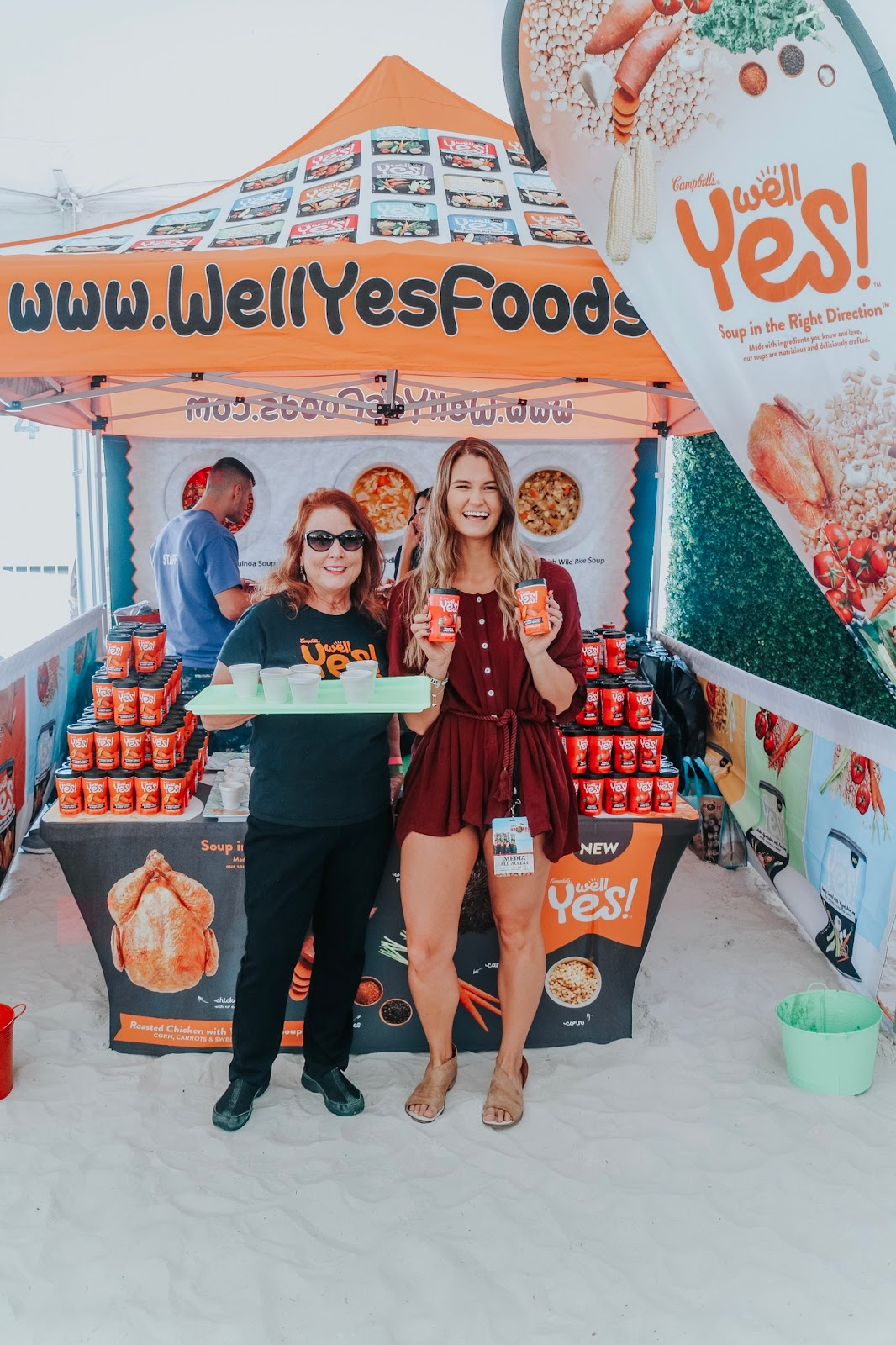 Tampa Bay Blogger at Clearwater Beach's Uncorked Food and Wine Festival posing with Campbell's Yes Well Soup