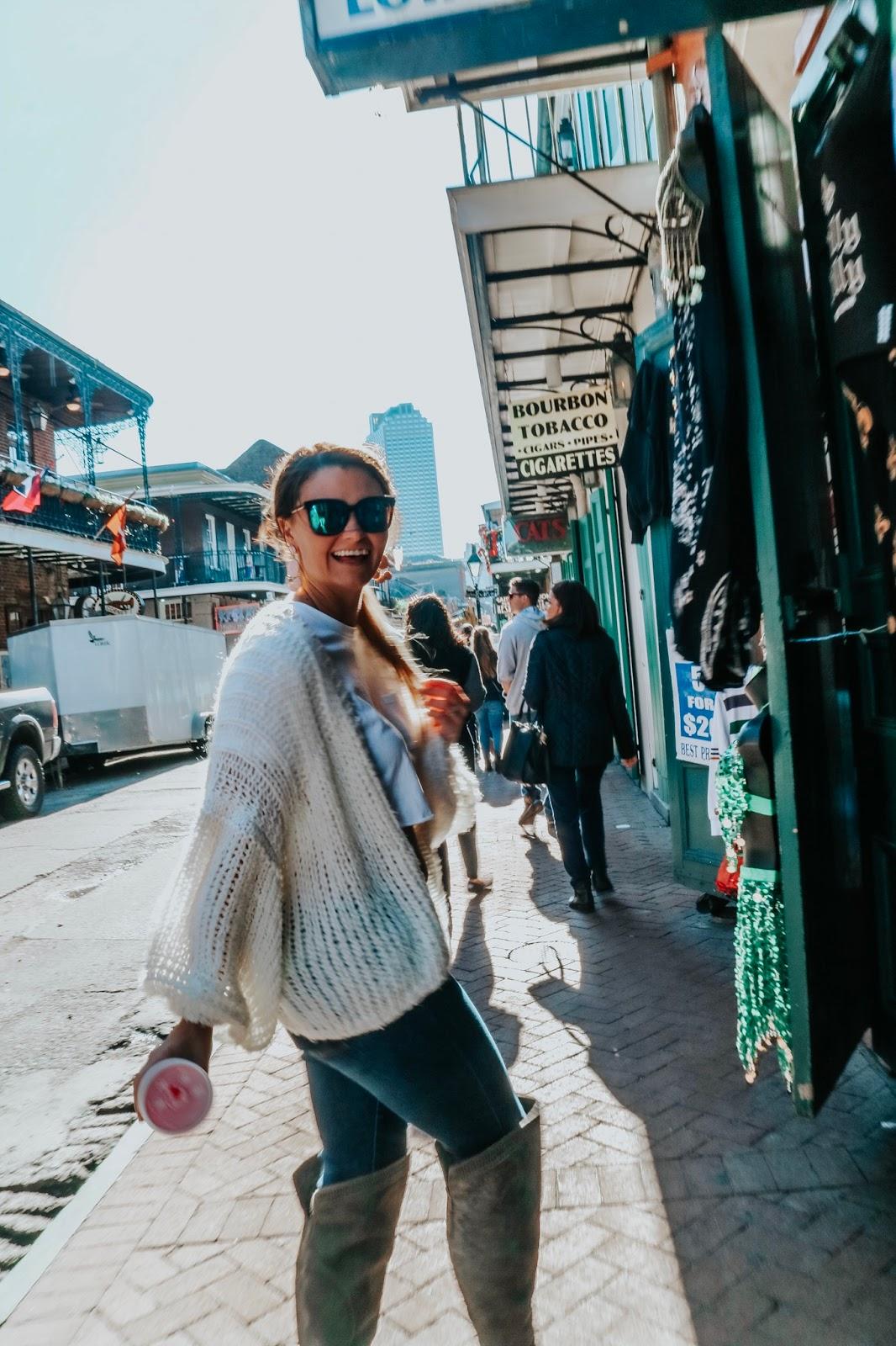 Travel blogger walking down Bourbon Street in New Orleans