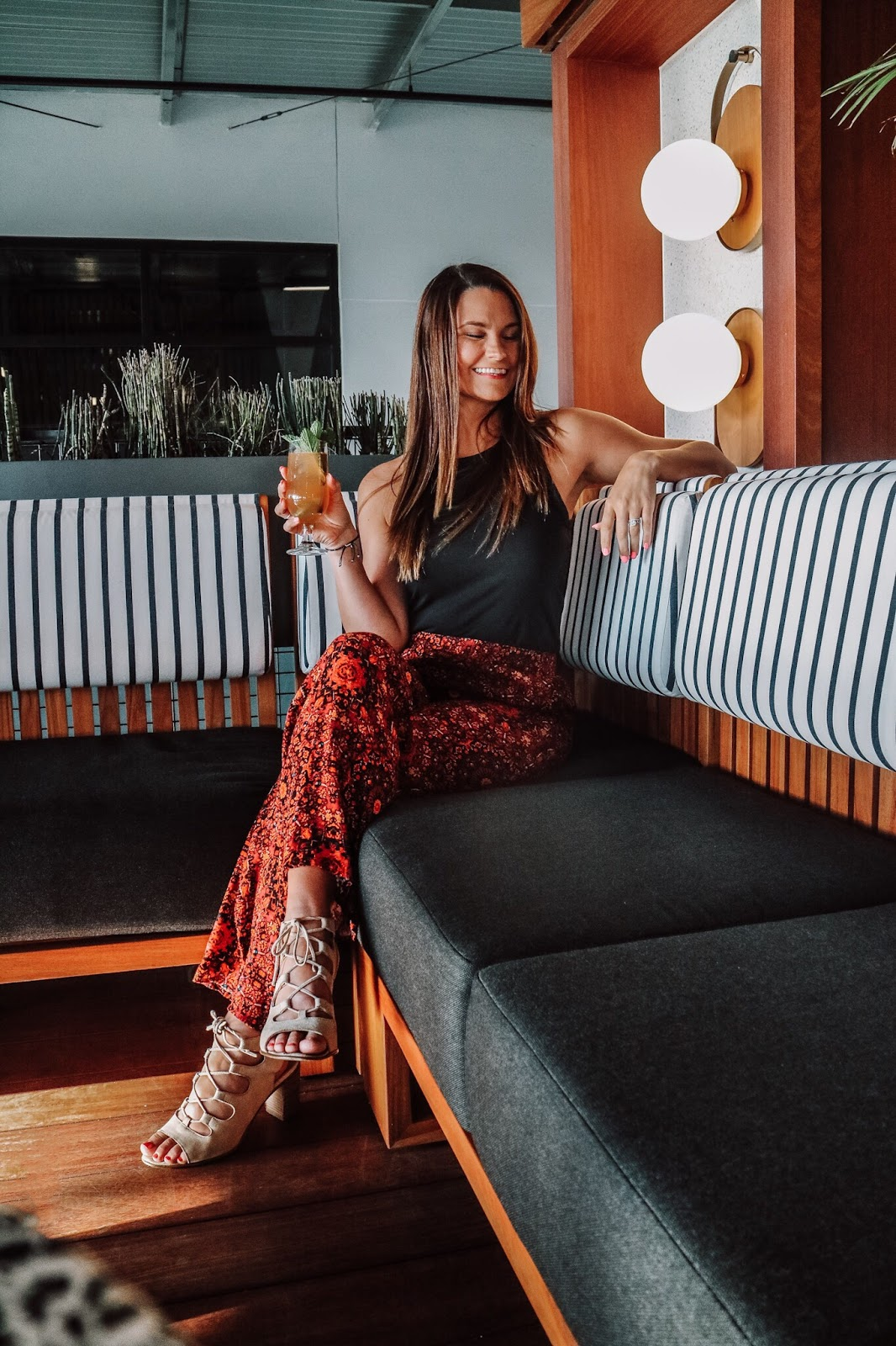 Tampa Bay blogger enjoying drinks at M.Bird, the new rooftop bar on top of Armature Works in Tampa, Florida