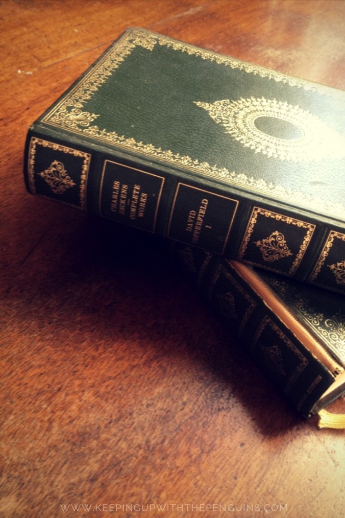 David Copperfield - Charles Dickens - two volume green hardcover set laid on wooden table - Keeping Up With The Penguins