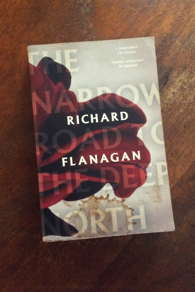 The Narrow Road To The Deep North - Richard Flanagan - Book Laid On Wooden Table - Keeping Up With The Penguins