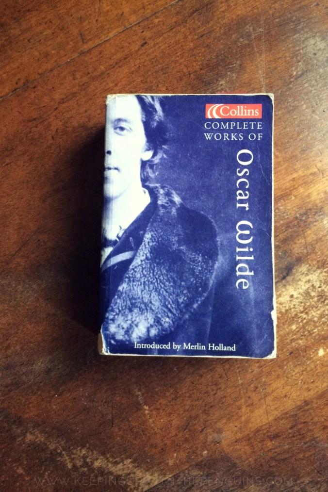 The Complete Works of Oscar Wilde - book laid on wooden table - Keeping Up With The Penguins