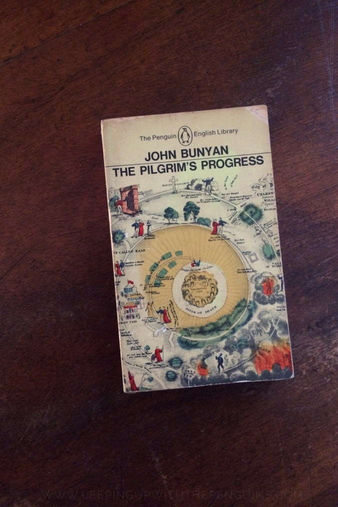 The Pilgrim's Progress - John Bunyan - Book Laid on Wooden Table - Keeping Up With The Penguins