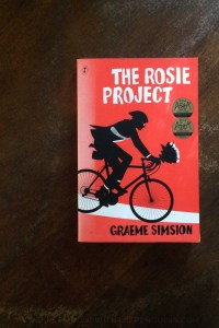 The Rosie Project - Graeme Simsion - Book Laid On Wooden Table - Keeping Up With The Penguins