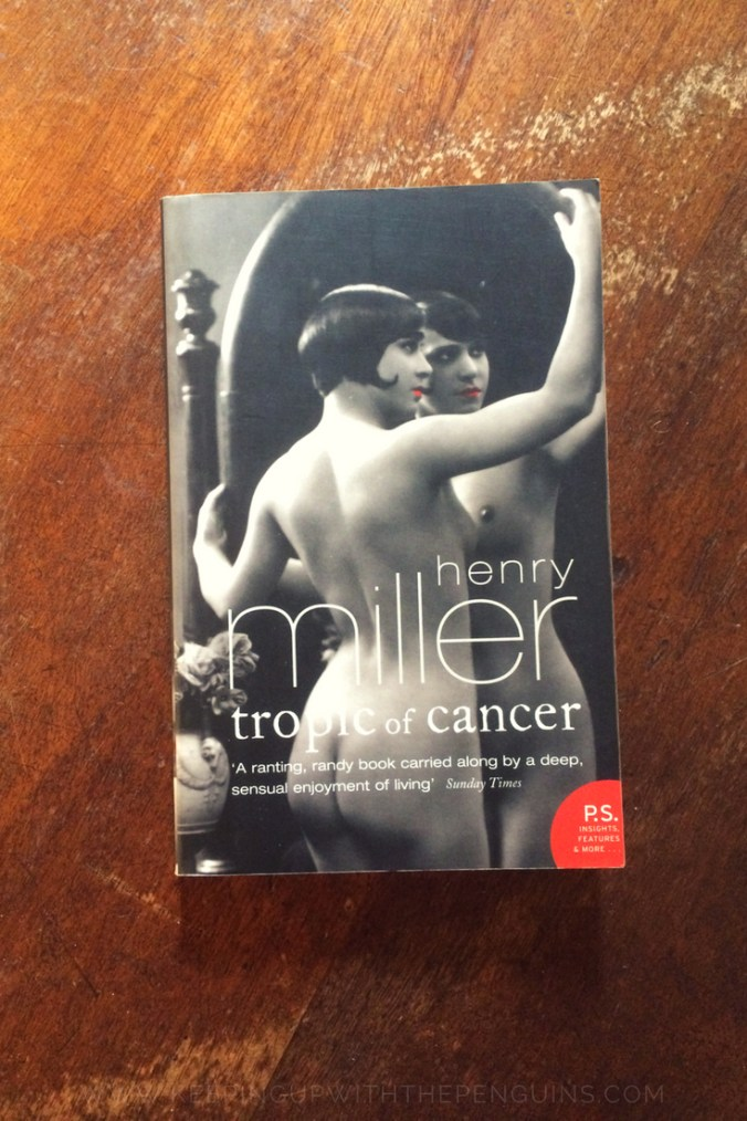 Tropic of Cancer - Henry Miller - Book Laid Flat on Wooden Table - Keeping Up With The Penguins