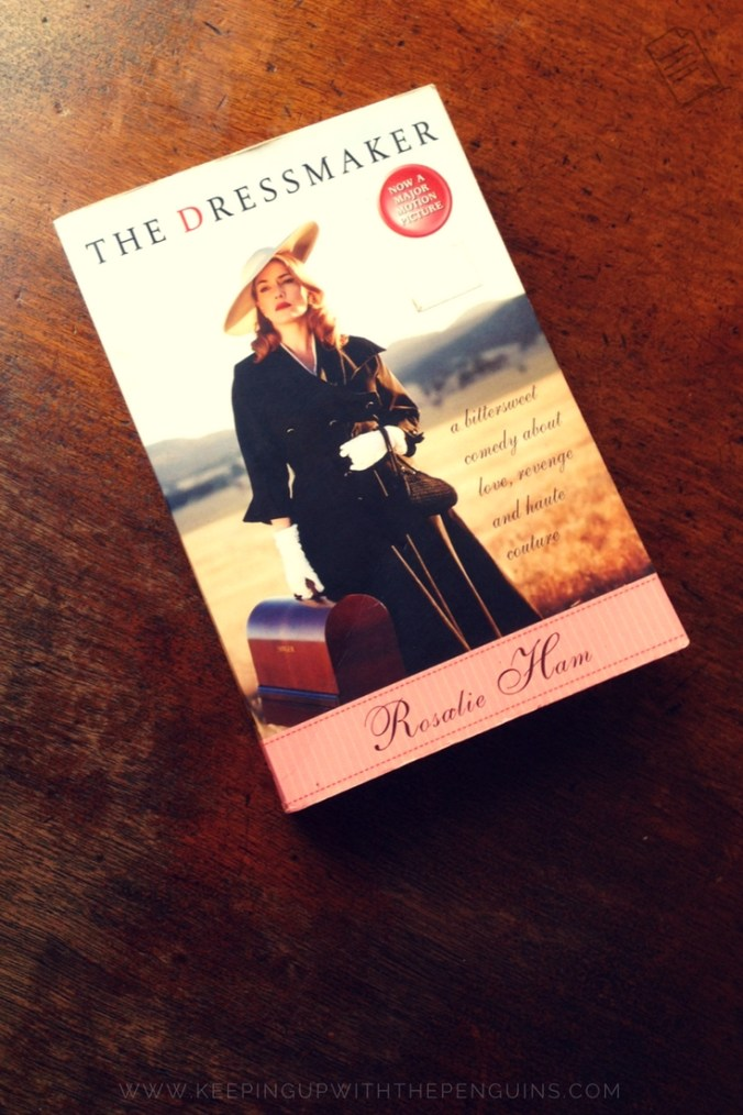 The Dressmaker - Rosalie Ham - book laid on a wooden table - Keeping Up With The Penguins