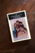 Little Women - Louisa May Alcott - Book Laid on Wooden Table - Keeping Up With The Penguins