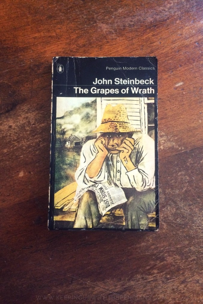 The Grapes Of Wrath - John Steinbeck - Book Laid on Wooden Table - Keeping Up With The Penguins